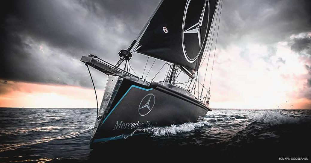 Scia yacht with dramatic grey sky in backgroun