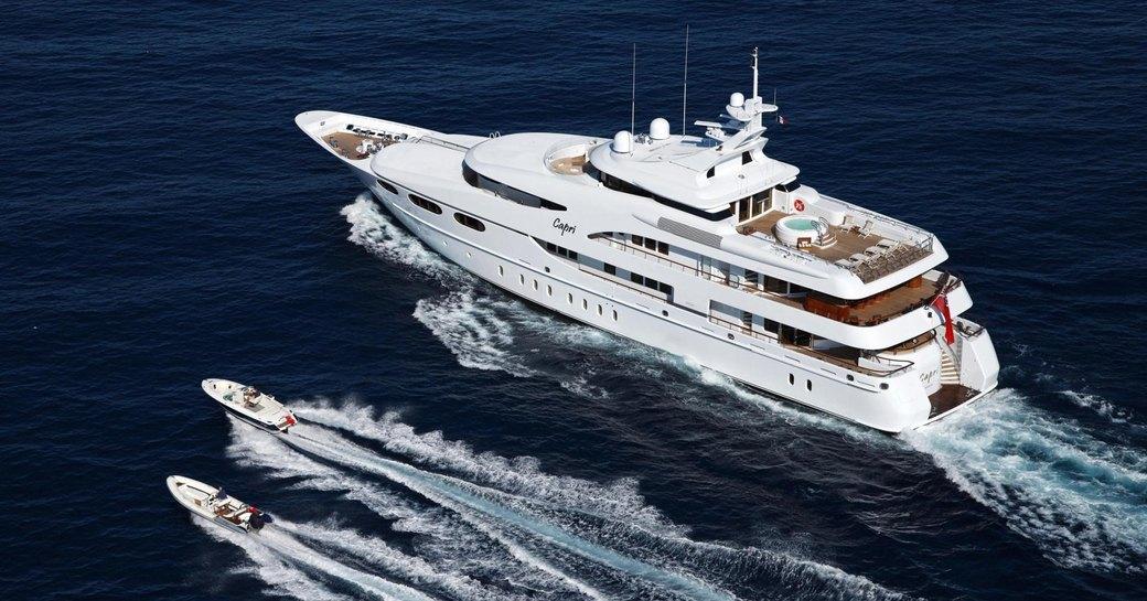 Lurssen superyacht 'Capri I' cruises in the Mediterranean alongside tenders