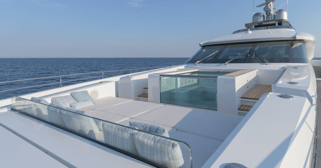 Sundeck with seating and Jacuzzi on superyacht EIV
