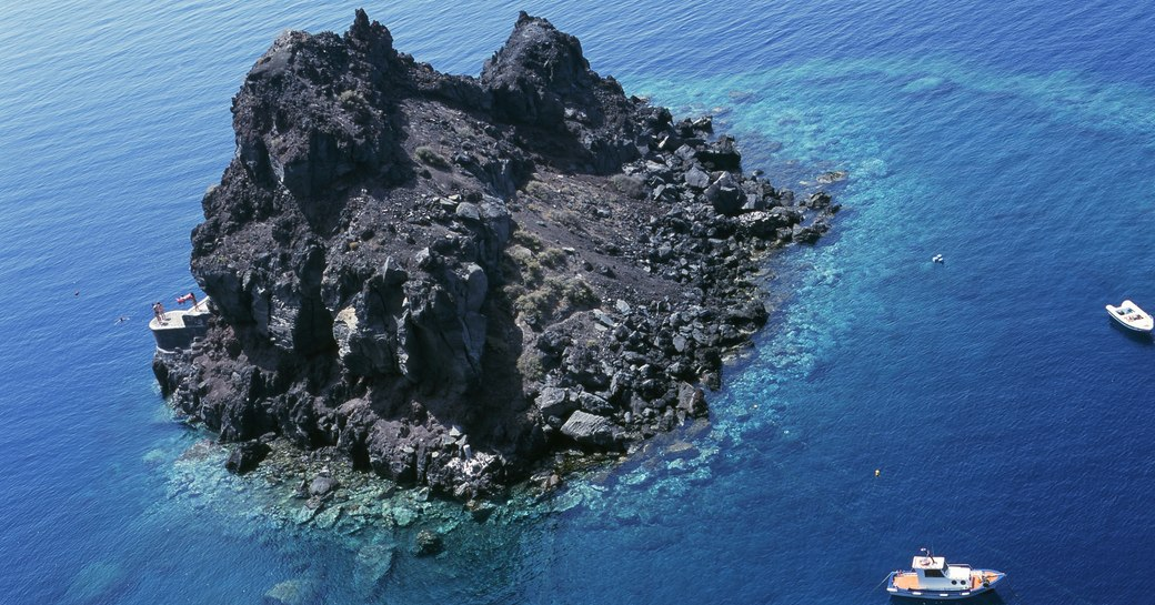 snorkellers and divers explore the marine-rich waters of Santorini