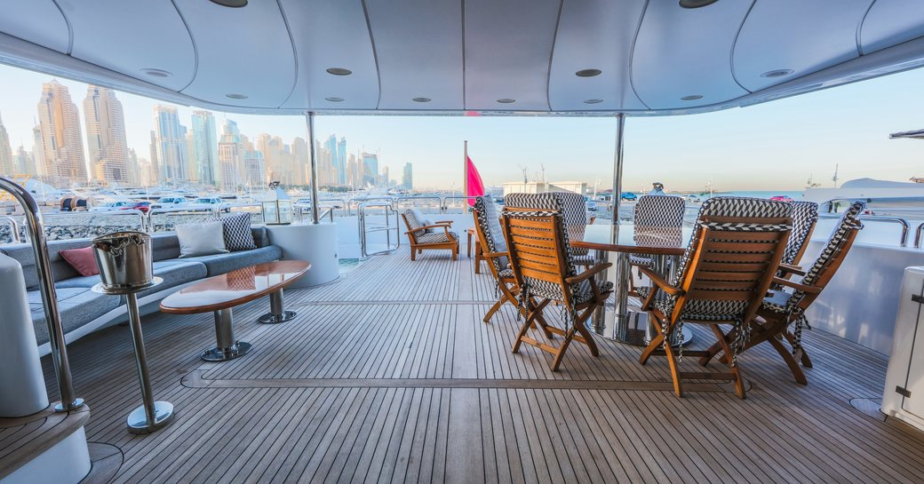 seating and casual dining area under the radar arch on the sundeck aboard luxury yacht DXB