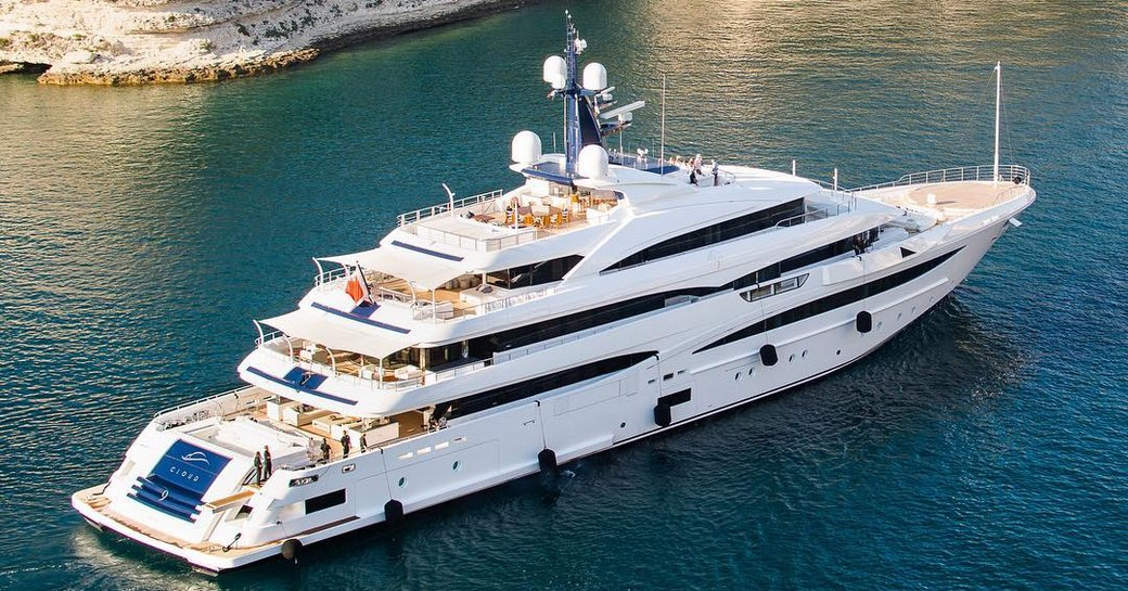 Luxury yacht 'Cloud 9' close to a green coast