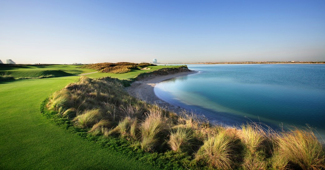 the sea meets the lush green golf course at Yas Links Golf Club in Abu Dhabi