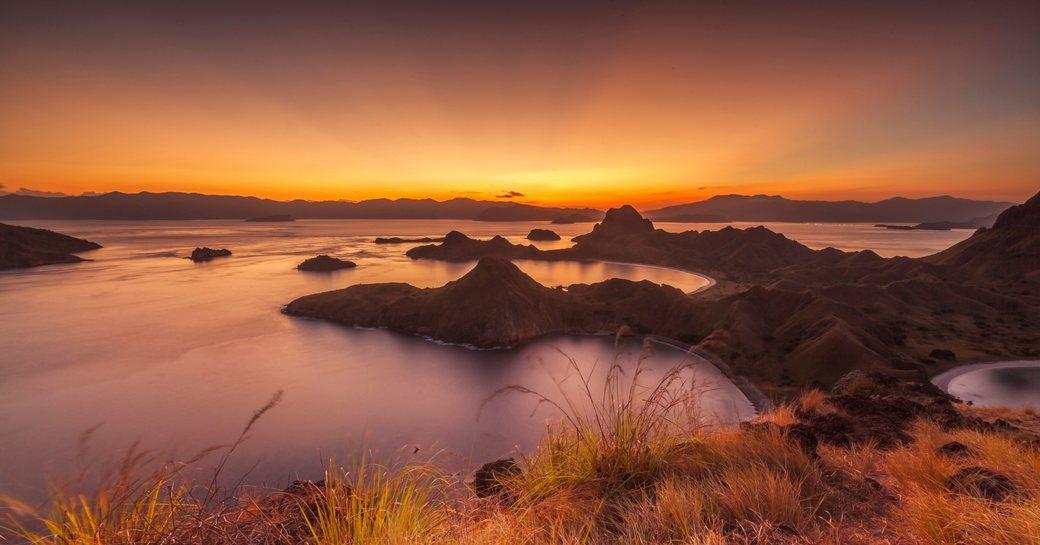 sun sets over the beautiful landscape of Komodo