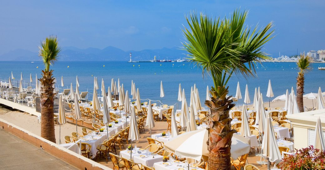 beachside restaurant looking out across the blue seas in Cannes