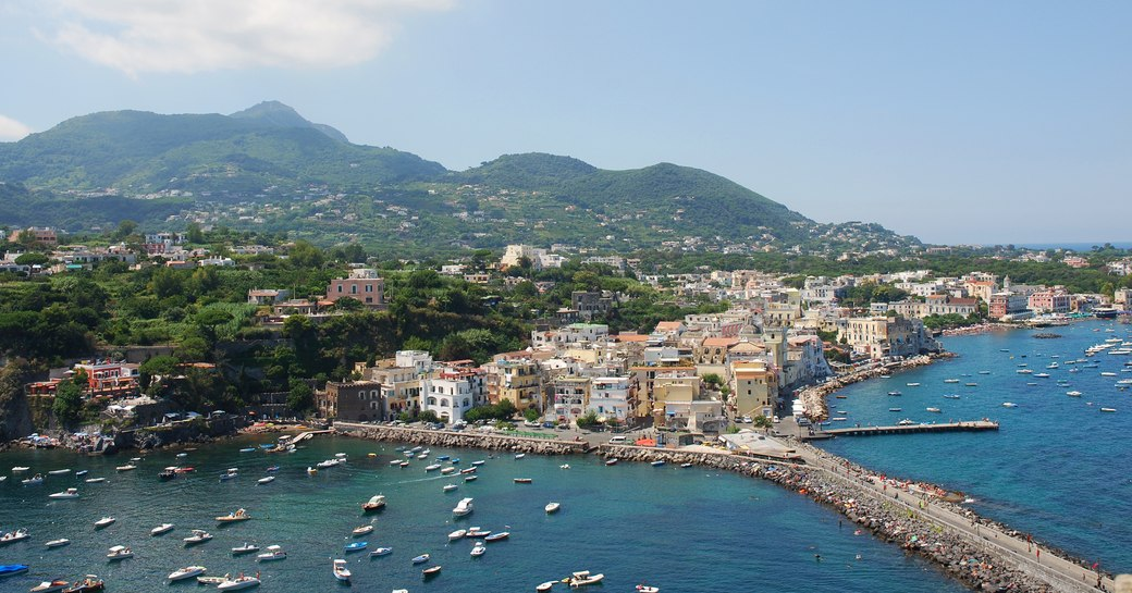 an italian marin where a fleet of luxury superyachts berth in peak season for a spledid festival in land bringing some excitement to a quaint settlement and to the guests of a luxury yacht charter