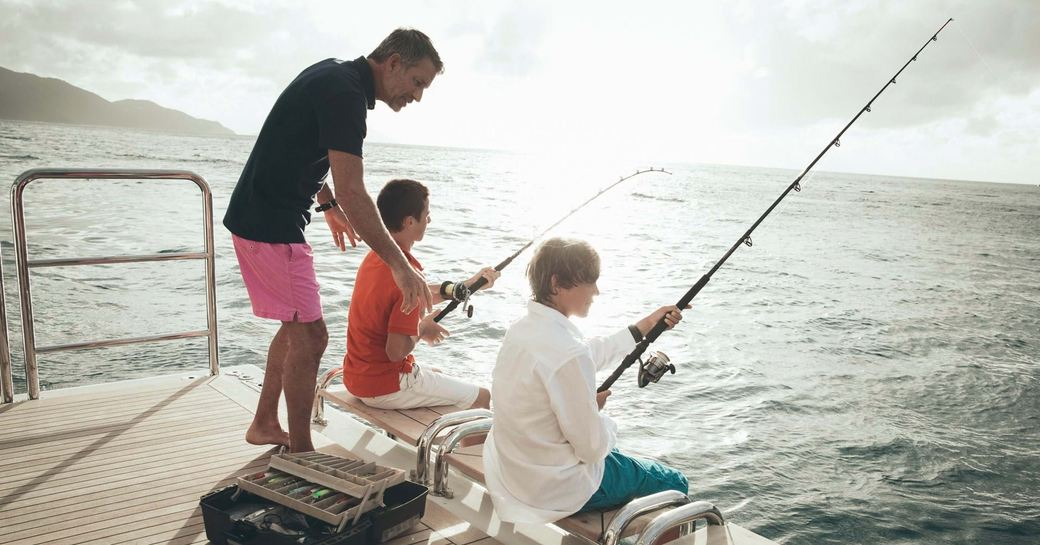 fishing on superyacht with rod and line
