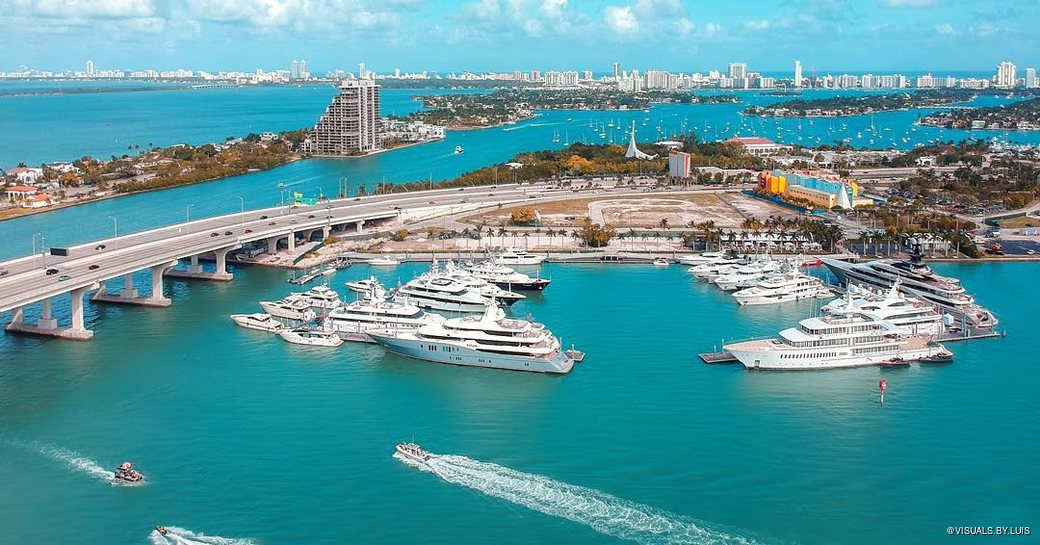 Aerial shot of Miami Yacht Show and Superyacht Miami, in downtown Miami at Biscayne Bay at One Herald Plaza and Watson Island Garden Marina