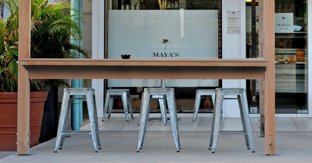 Silver Stools at the wooden bar outside of Maya's To-Go in St Barts