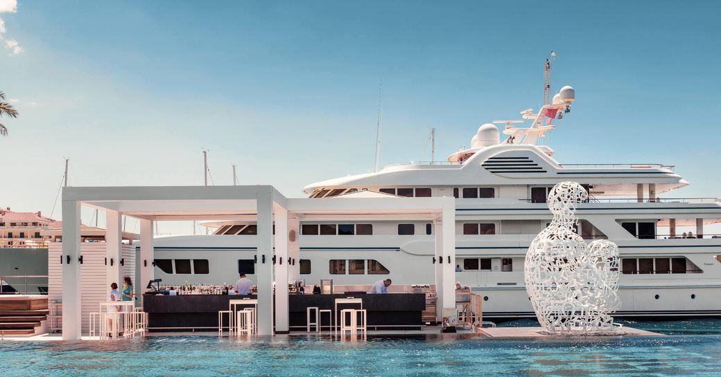 superyacht berths behind infinity pool in Porto Montenegro, Tivat