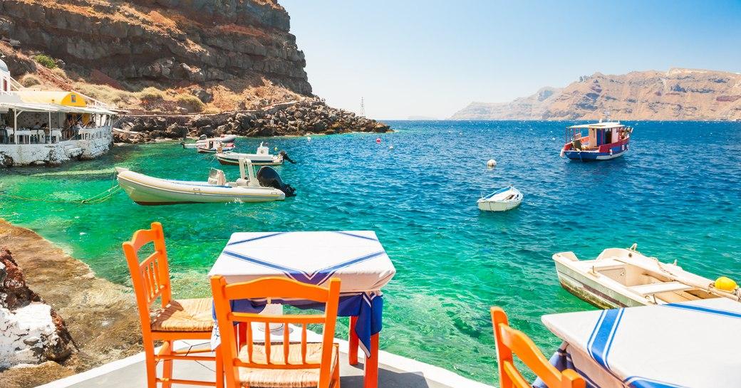 Santorini restaurant in a quiet harbour, Greece