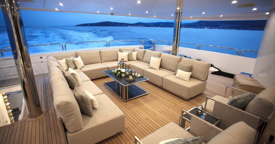 chic alfresco lounge aboard motor yacht Princess AVK