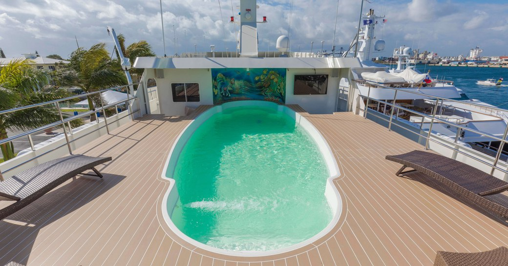 swimming pool on the sundeck of luxury yacht GLOBAL