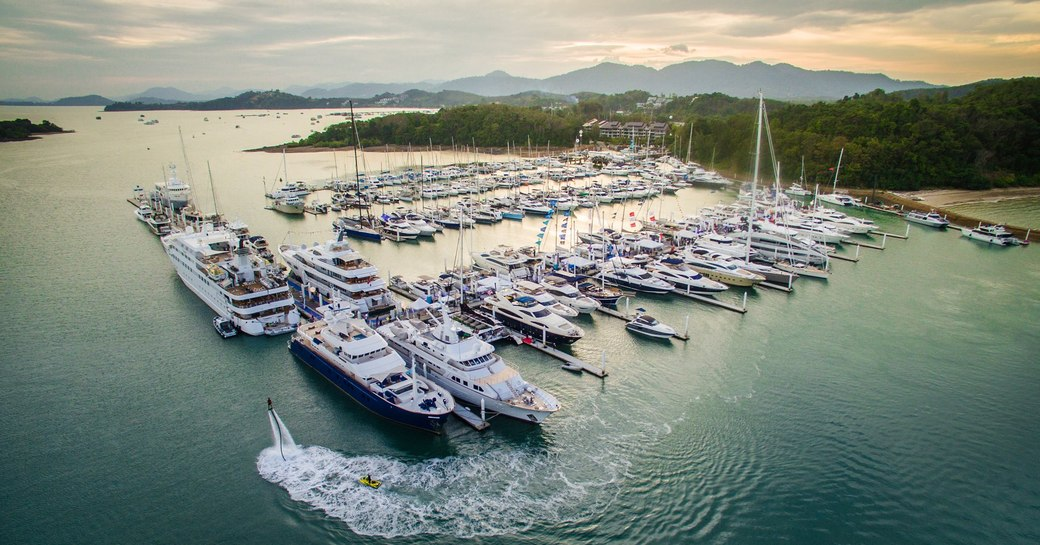 yachts and superyachts line up in Phuket Marina for the Thailand Yacht Show & Rendezvous