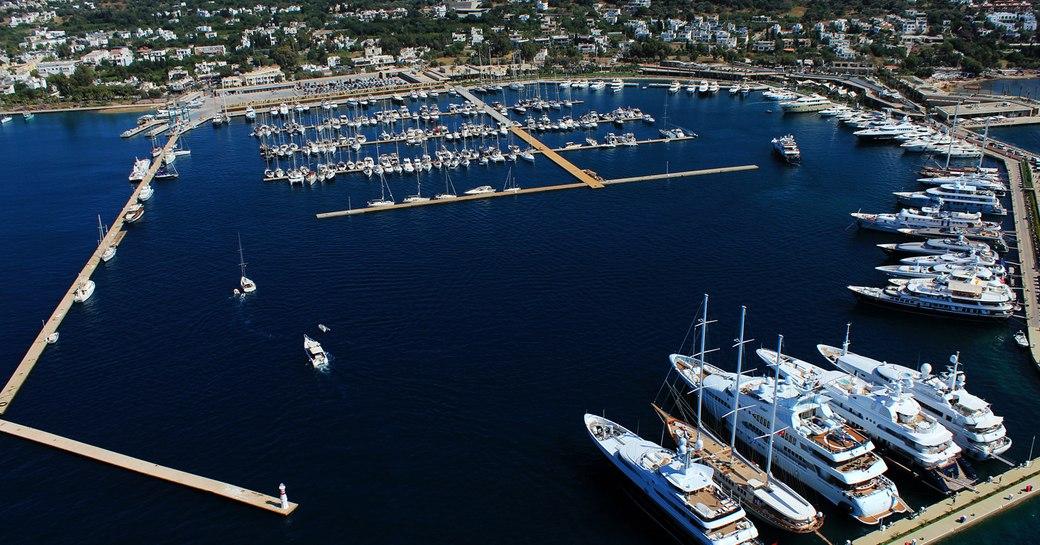 aerial shot of luxury yachts lined up in Yalikavak Marina