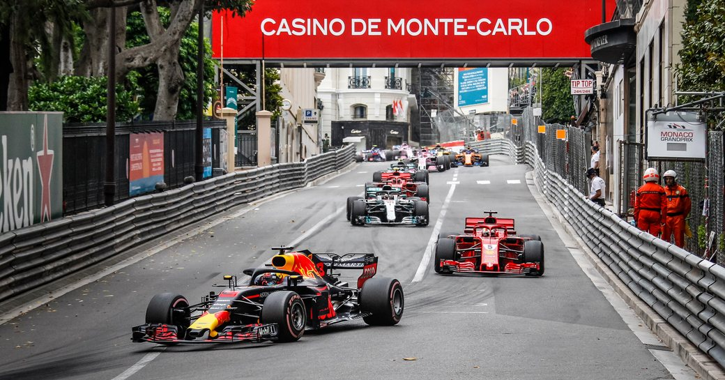 Cars racing on the track in Monaco during Grand Prix