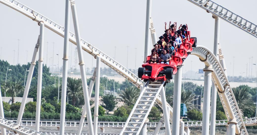 visitors on a roller coaster at Ferrari World Abu Dhabi