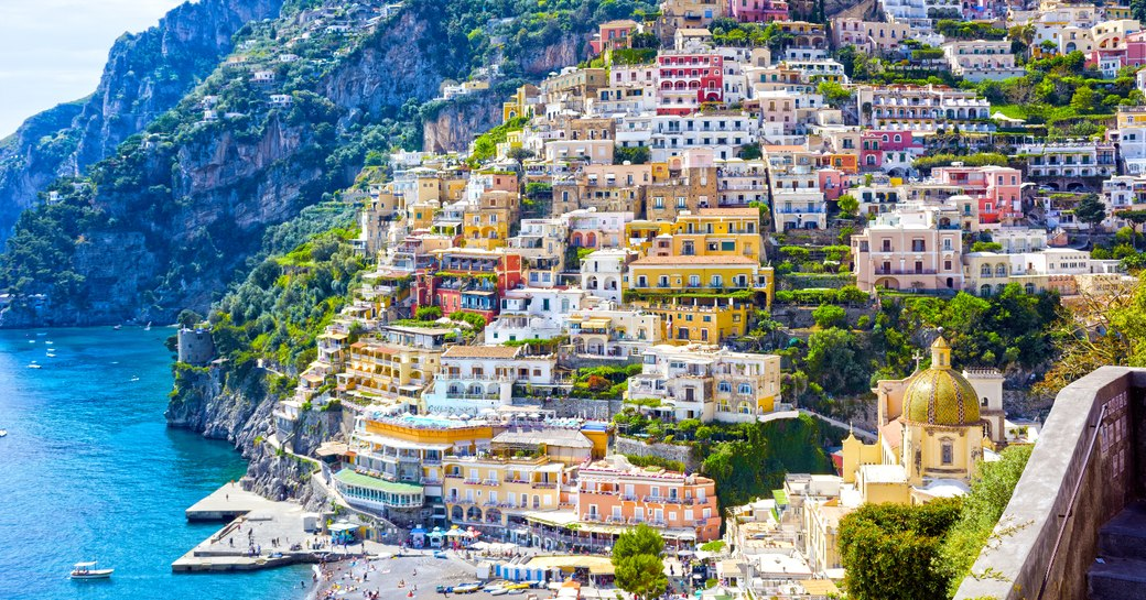 The town of Positano on the Amalfi Coast, with views over rugged mountains and blue sea