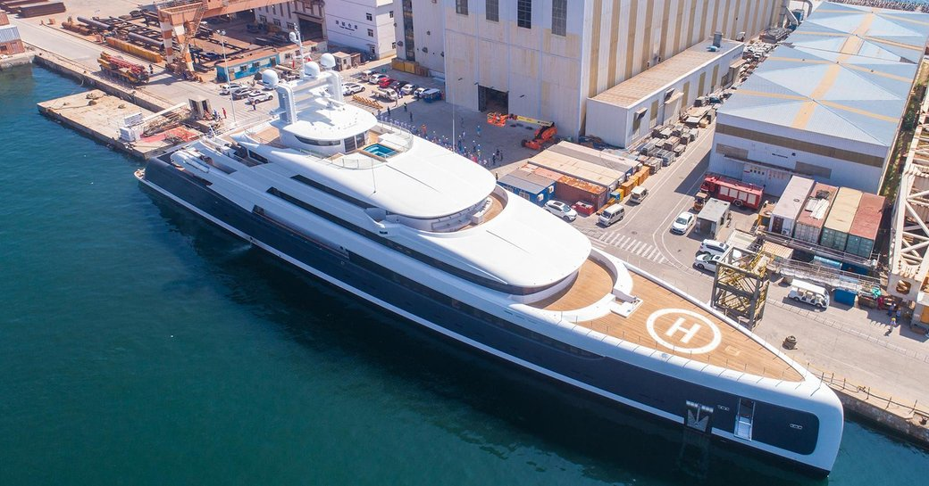 motor yacht Illusion Plus outside yard's facilities following her delivery