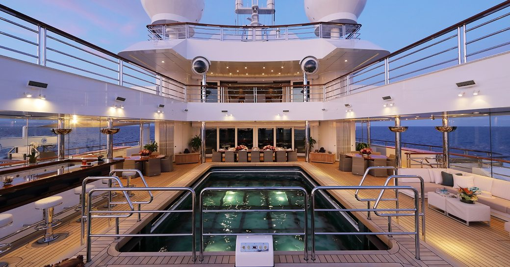 Aft deck swimming pool onboard MY Octopus
