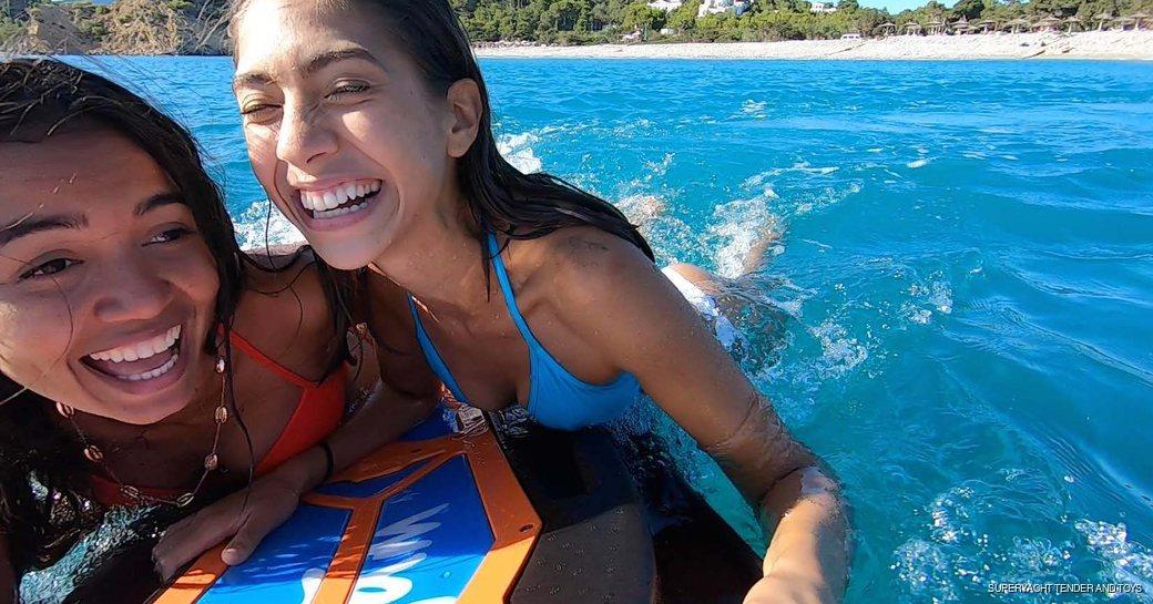 Kids enjoying a Wave Jam surfboard on the water