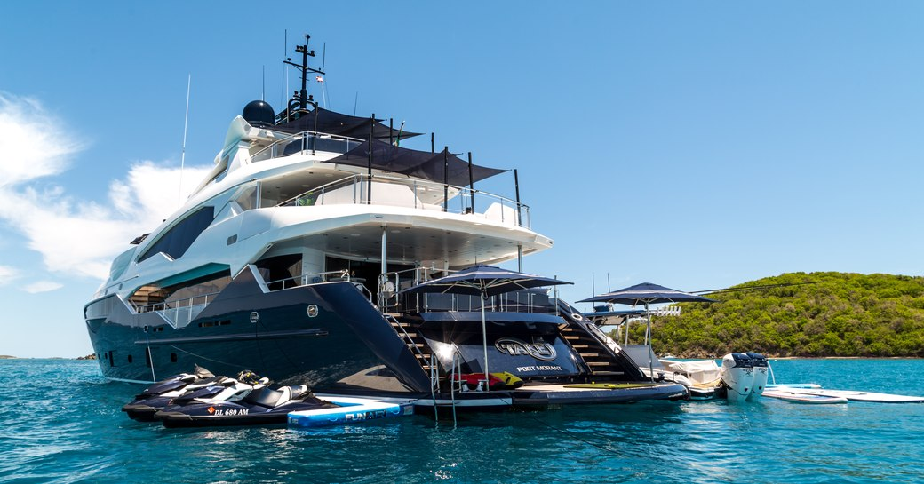 water toys gather around superyacht Take 5 when anchored on a luxury yacht charter
