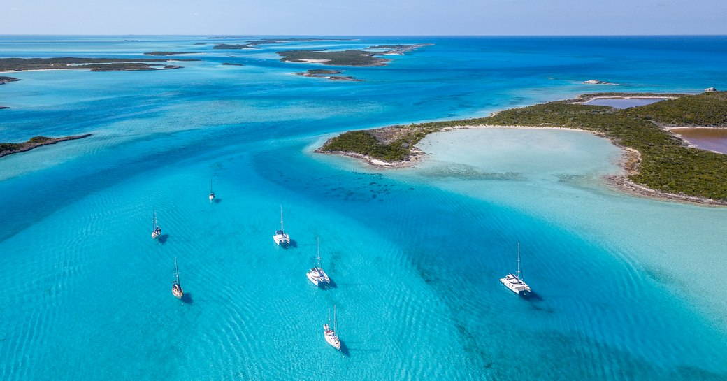 Yachts in clear waters of Exumas in Bahamas