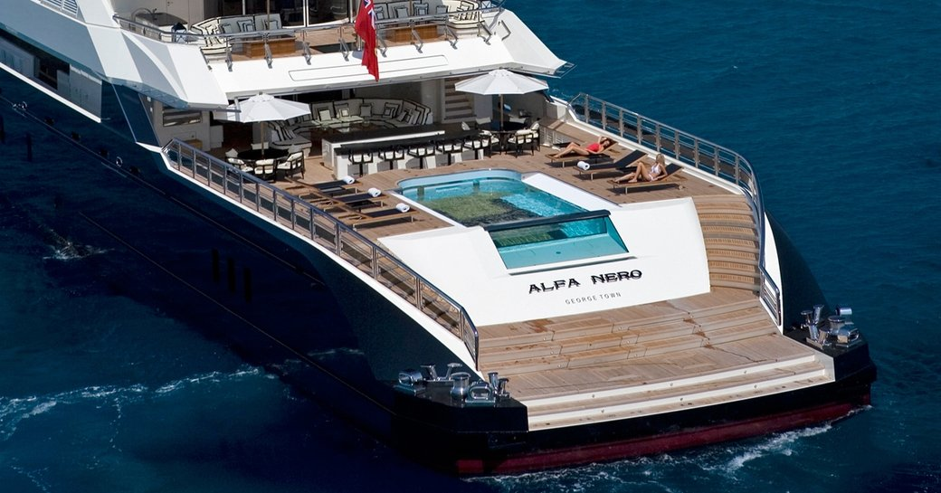 pool, bar, sun loungers and seating on the huge aft deck of superyacht 'Alfa Nero'