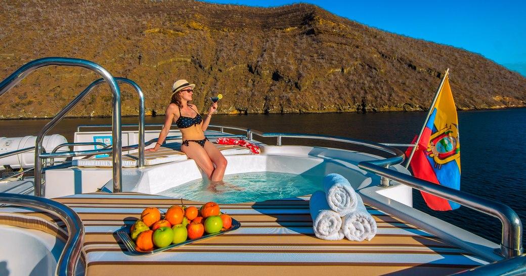 A woman enjoys a drink onboard MY Treasure
