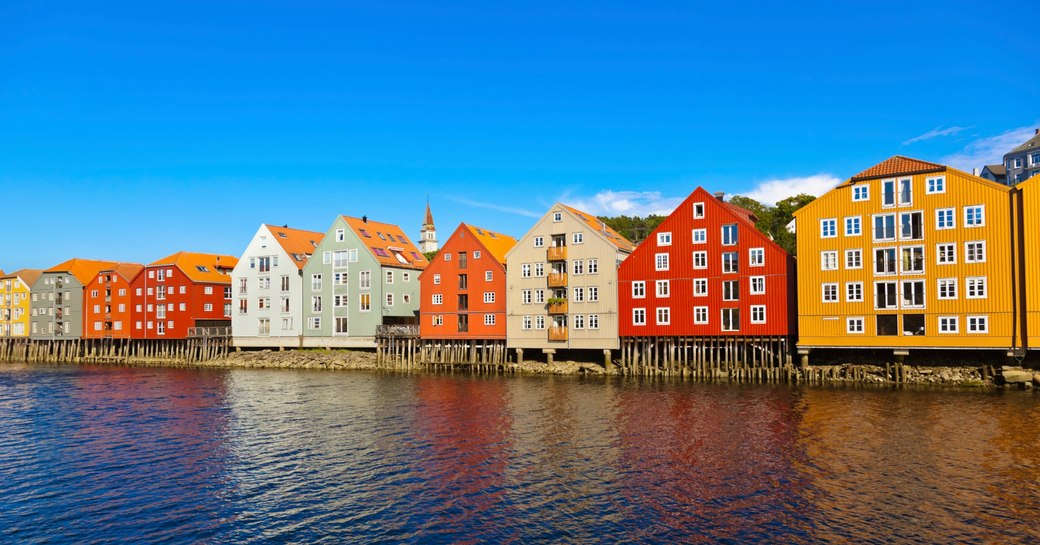 colourful houses along the water's edge in Trondheim Norway