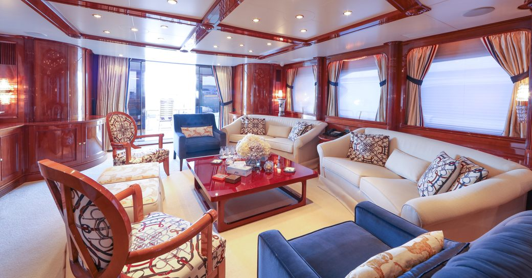 sofas and armchairs in the classically styled main salon aboard luxury yacht DXB