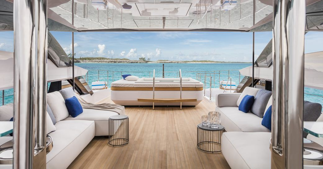 seating area and spa pool on the sundeck of luxury yacht Vista Blue