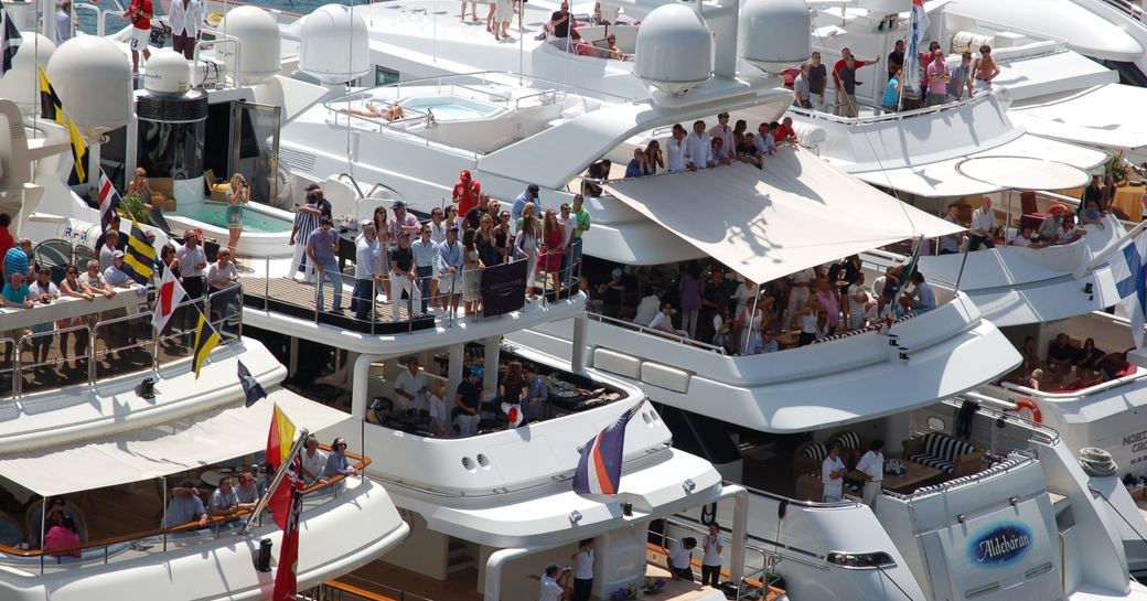 crowds gather on superyachts lined-up trackside at the Monaco Grand Prix