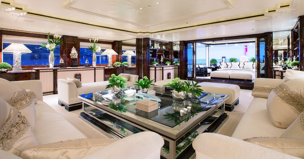 opulent lounge area forming part of the main salon aboard charter yacht 'Lioness V'