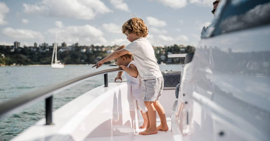 Kids onboard the Axopar Suntop chase tender
