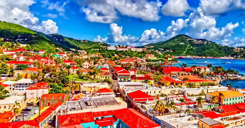 Panoramic view over town in US Virgin islands, with blue sky and hills in background
