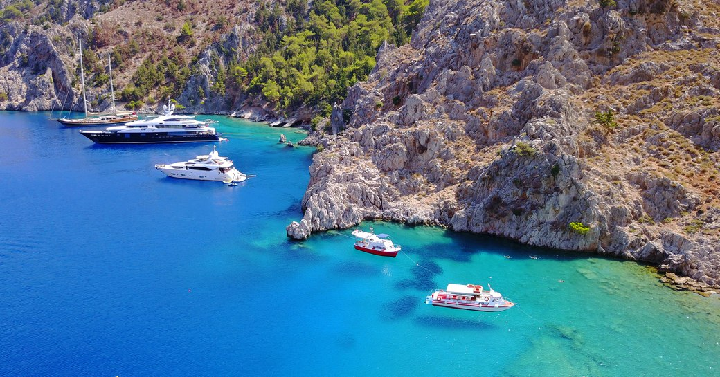 Yachts anchored in beautiful turquoise water in Greece