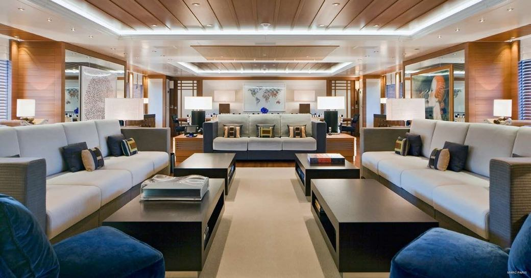 three large sofas in the contemporary main salon aboard superyacht Mary-Jean II