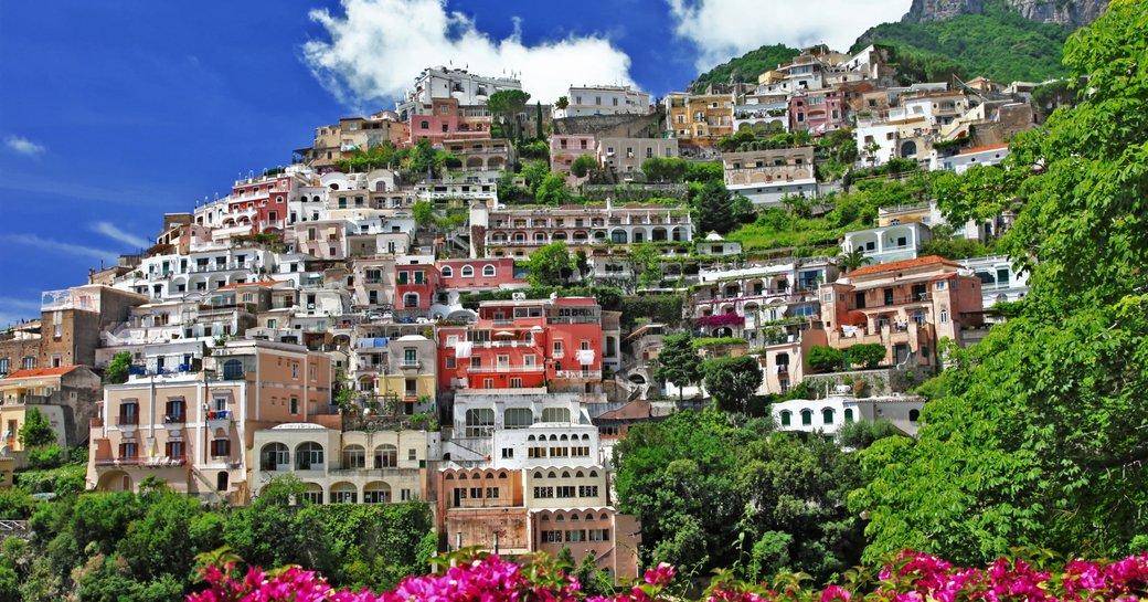 pastel coloured houses tumble down the hillside in Positano, Amalfi Coast, Italy