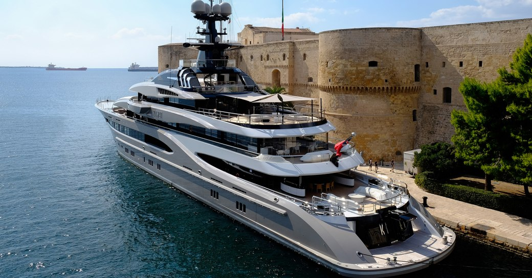 Superyacht KISMET in Taranto, Italy with buildings in background during filming of Michael Bay movie 6 Underground