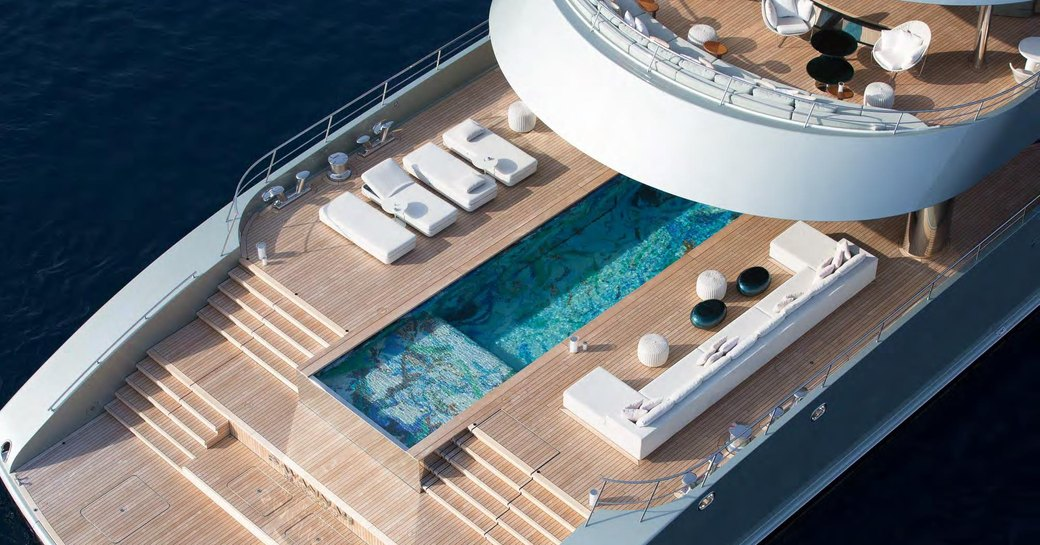 Superyacht SAVANNAH viewed from above showing pool and sunloungers
