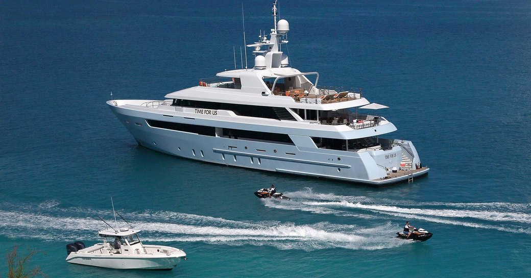 time for us superyacht at anchor with two tenders