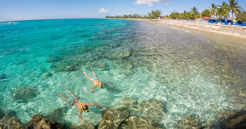 Snorkellers exploring the crystal-clear water in Eleuthera