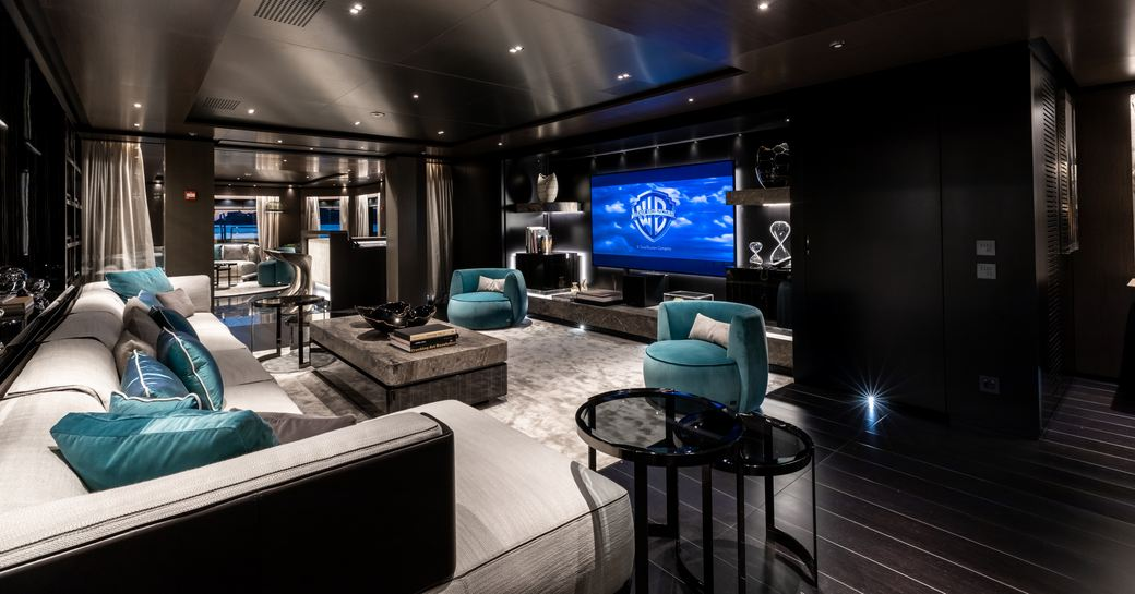 sofa facing a large widescreen TV in the modern main salon aboard luxury yacht SOLO