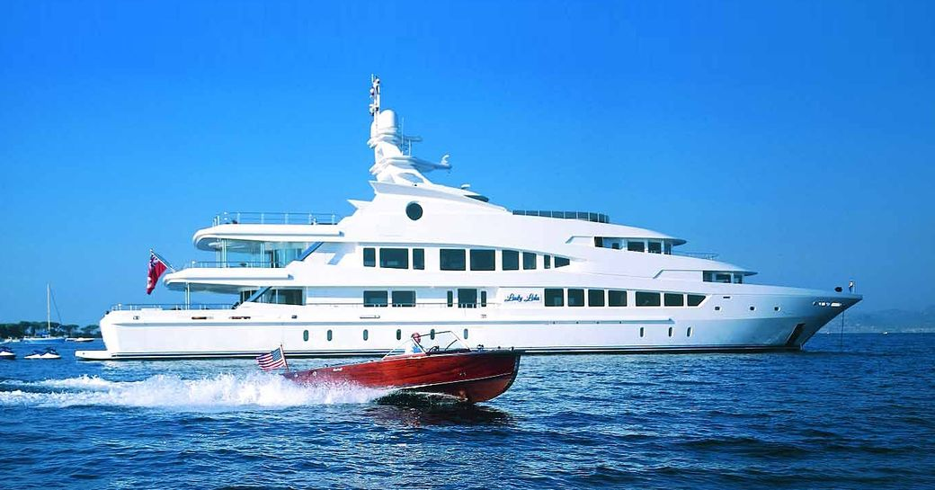 superyacht Lucky Lady cruises alongside tender