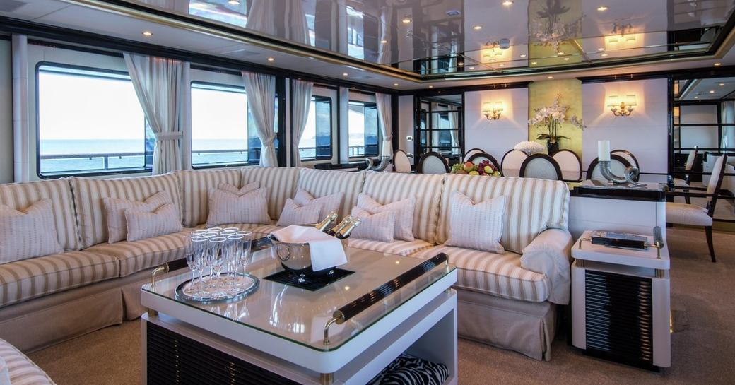 classically styled main salon with comfortable sofa aboard superyacht DIANE