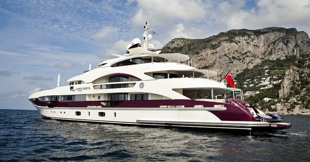 motor yacht QUITE ESSENTIAL anchored on a private yacht charter