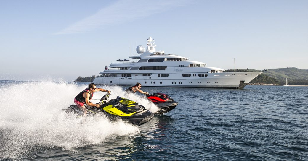 charter guests staying on board superyacht TITANIA take to the water
