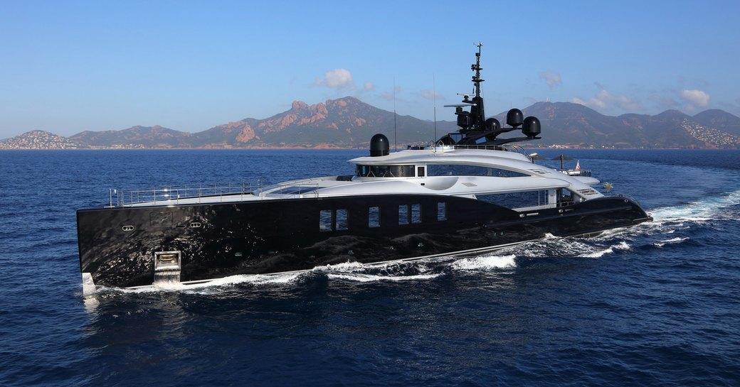 dynamic profile of superyacht OKTO as she cruises on a luxury yacht OKTO