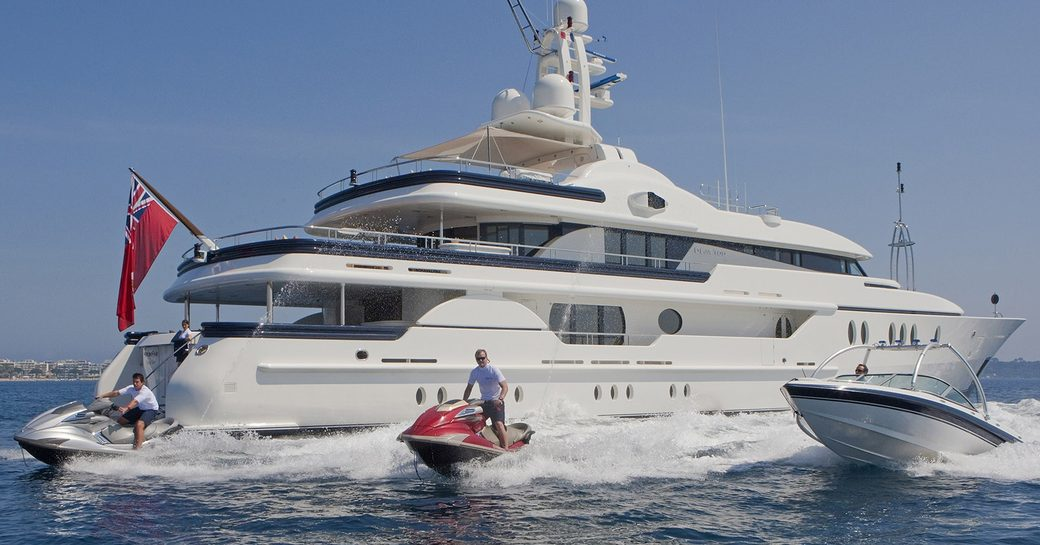 superyacht Deja Too anchors on a charter while jet skis and tender takes to the waters